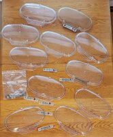 clear endcaps -10  NOS, 1 used + emblems & tabs.jpg